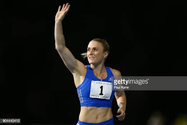 Sally Pearson acknowledges the spectators after competing in and winning the women's 100 metre hurdles during the Jandakot Airport Perth Track...