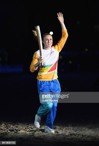 Sally Pearson carries The Queen's Baton during the Opening Ceremony for the Gold Coast 2018 Commonwealth Games at Carrara Stadium on April 4 2018 on...
