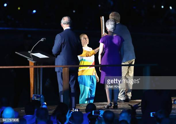 Sally Pearson hands The Queen's Baton to Chairman of Gold Coast 2018 Commonwealth Games Corporation Peter Beattie during the Opening Ceremony for the...