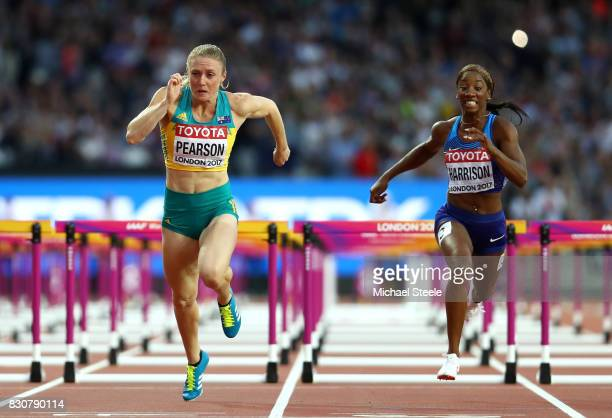 Sally Pearson of Australia and Kendra Harrison of the United States cross the finish line in the Women's 100 metres hurdles final during day nine of...
