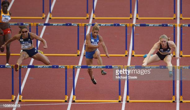 Sally Pearson of Australia and Team AsiaPacific on her way to victory in the women's 100m hurdles from Nevin Yanit of Turkey and Team Europe and Lolo...