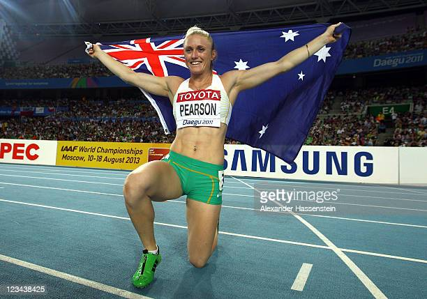 Sally Pearson of Australia celebrates victory in the women's 100 metres hurdles final during day eight of 13th IAAF World Athletics Championships at...