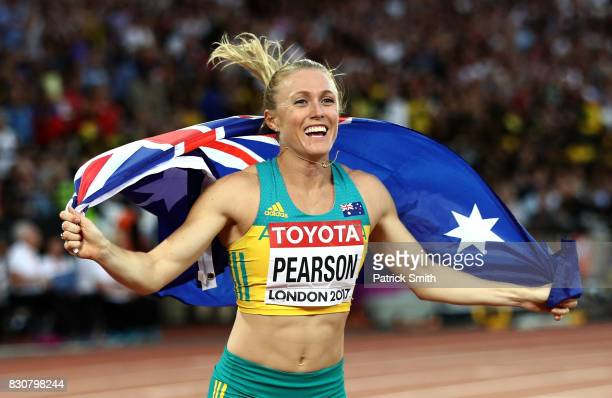 Sally Pearson of Australia celebrates with an Australian flag after winning gold in the Women's 100 metres hurdles final during day nine of the 16th...