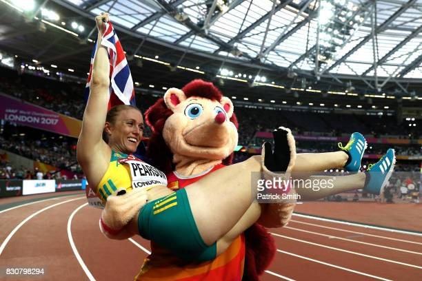 Sally Pearson of Australia celebrates with an Australian flag and Hero the Hedgehog after winning gold in the Women's 100 metres hurdles final during...