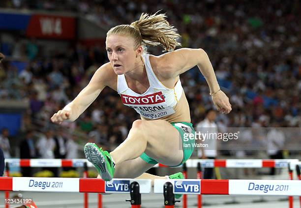 Sally Pearson of Australia competes on her way to victory in the women's 100 metres hurdles final during day eight of 13th IAAF World Athletics...