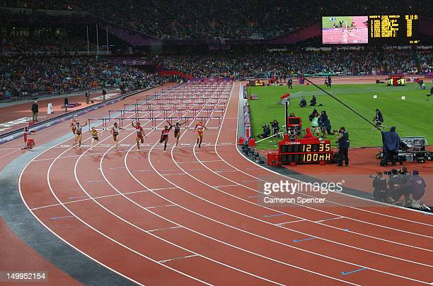 Sally Pearson of Australia crosses the finish line ahead of Dawn Harper and Kellie Wells of the United States to win the Women's 100m Hurdles Final...