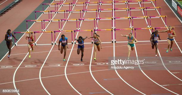 Sally Pearson of Australia crosses the finish line as winner ahead of Kendra Harrison of the USA and Pamela Dutkiewicz of Germany in the Women's 100...