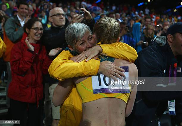 Sally Pearson of Australia hugs her coach Sharon Hannan after winning the gold medal in the Women's 100m Hurdles Final on Day 11 of the London 2012...