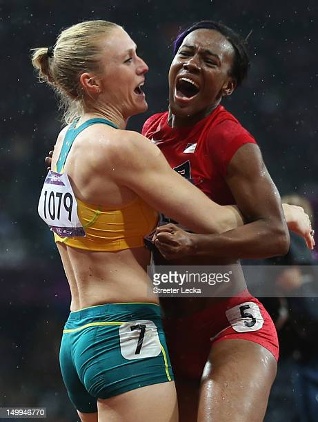 Sally Pearson of Australia hugs Kellie Wells of the United States after winning the gold medal in the Women's 100m Hurdles Final on Day 11 of the...