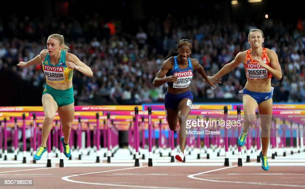 Sally Pearson of Australia Kendra Harrison of the United States and Nadine Visser of Netherlands cross the finish line in the Women's 100 metres...
