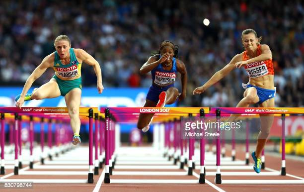 Sally Pearson of Australia Kendra Harrison of the United States and Nadine Visser of Netherlands compete in the Women's 100 metres hurdles final...