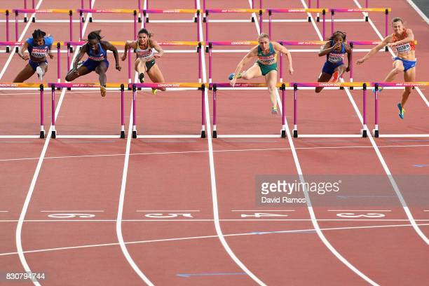 Sally Pearson of Australia leads Dawn Harper Nelson of the United States and Pamela Dutkiewicz of Germany in the Women's 100 metres hurdles final...