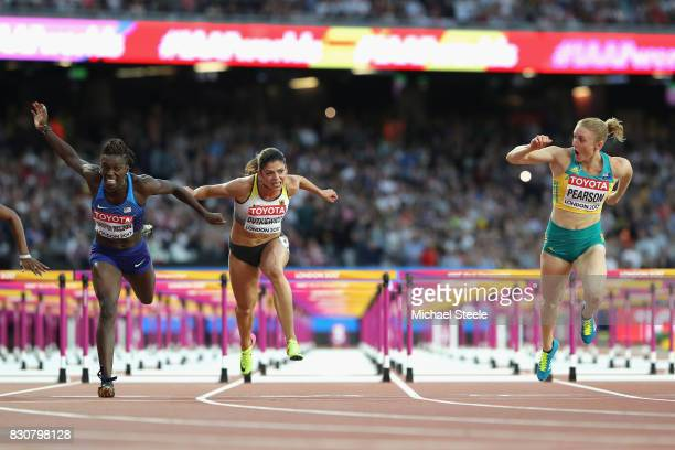 Sally Pearson of Australia leads Dawn Harper Nelson of the United States and Pamela Dutkiewicz of Germany across the finish line in the Women's 100...