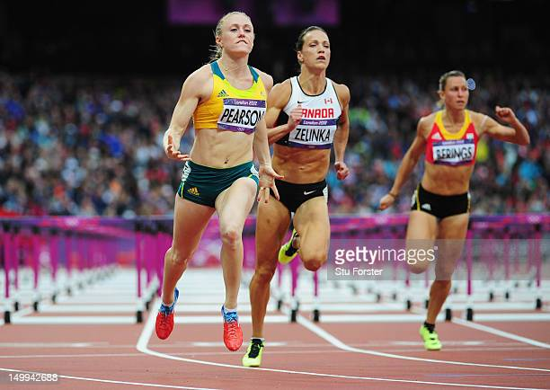 Sally Pearson of Australia leads Jessica Zelinka of Canada and Eline Berings of Belgium in the Women's 100m Hurdles Semifinals on Day 11 of the...