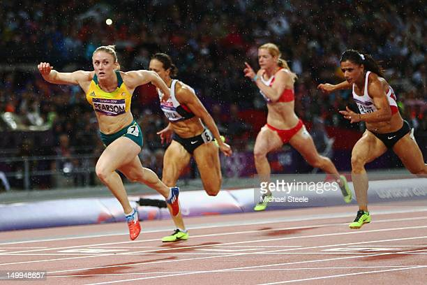 Sally Pearson of Australia leads Jessica Zelinka of Canada and Nevin Yanit of Turkey during the Women's 100m Hurdles Final on Day 11 of the London...