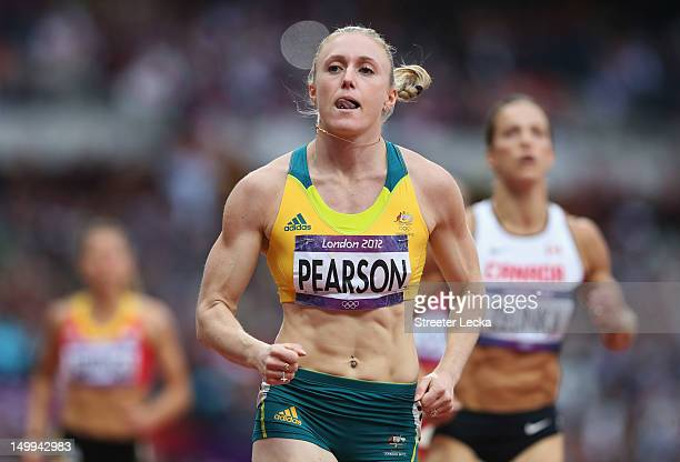 Sally Pearson of Australia leads Jessica Zelinka of Canada in the Women's 100m Hurdles Semifinals on Day 11 of the London 2012 Olympic Games at...