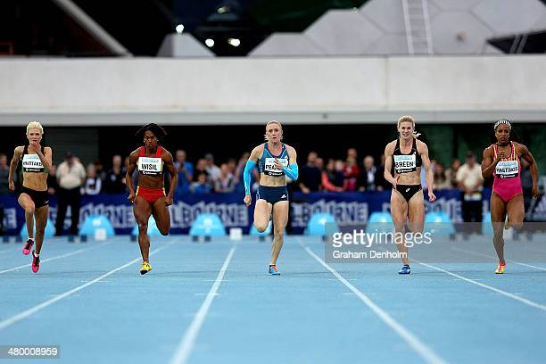 Sally Pearson of Australia leads the field in the Women's 100 metres Open during the IAAF Melbourne World Challenge at Olympic Park on March 22 2014...