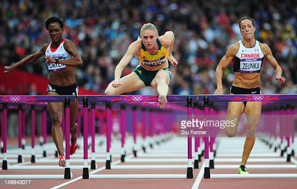 Sally Pearson of Australia leads Tiffany Porter of Great Britain and Jessica Zelinka of Canada in the Women's 100m Hurdles Semifinals on Day 11 of...
