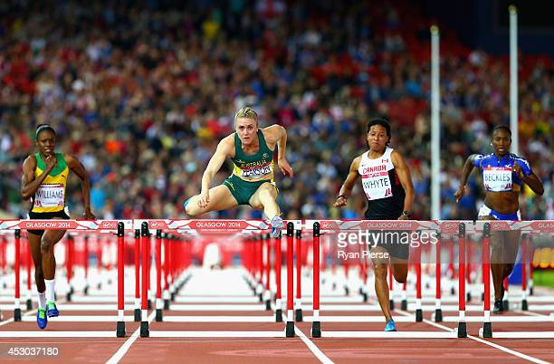 Sally Pearson of Australia on her way to winning gold in the Women's 100 metres hurdles finalat Hampden Park during day nine of the Glasgow 2014...