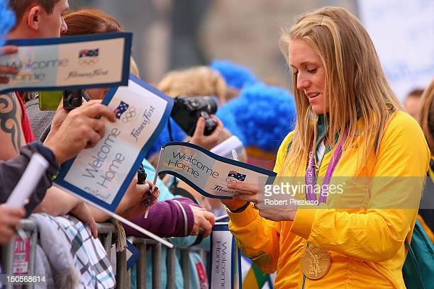 Sally Pearson signs autographs for fans during the Australian Olympic Team Homecoming Parade at Federation Square on August 22 2012 in Melbourne...