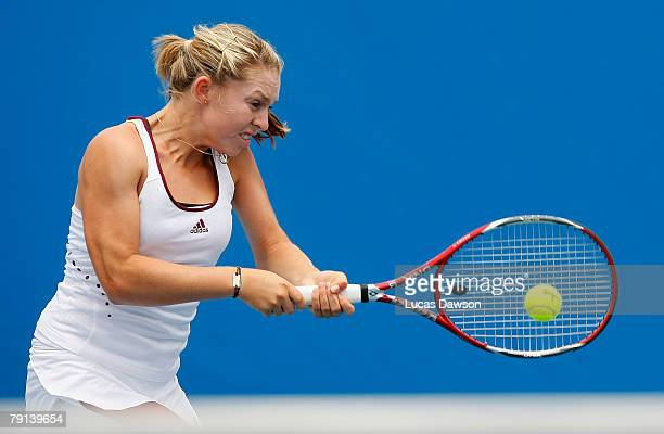 Sally Peers of Australia plays a backhand during her junior doubles match with Isabella Holland of Australia against Simona Halep of Romania and...