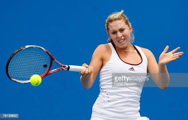 Sally Peers of Australia plays a forehand during her junior doubles match with Isabella Holland of Australia against Simona Halep of Romania and...