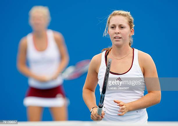 Sally Peers of Australia prepares to return serve during her junior doubles match with Isabella Holland of Australia against Simona Halep of Romania...