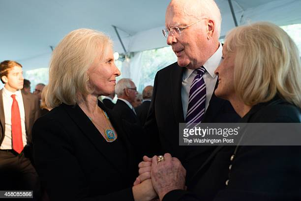Sally Quinn left talks to Senator Patrick Leahy center and his wife Marcelle Pomerleau right A post funeral reception was held at The Bradlee/Quinn...
