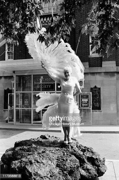 Sally Rand fan dancer performs and presents fans to Chicago Historical Society 1601 North Clark Street Chicago Illinois August 30 1966