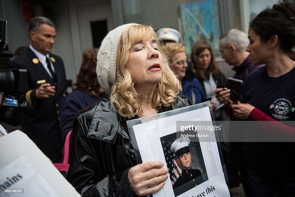 Sally Regenhard, mother of fire fighter Christian Regenhard, a victim of the September 11, 2001 attack, and other victim's family members protest the decision by city officials to keep unidentified human remains of the 9-11 victims at the 9-11 Museum at the World Trade Center site, on May 10, 2014 in New York City. The decision by city officials to keep the remains at the museum until they are able to be identified has drawn both support and criticism by families of victims. The remains were moved early this morning from the medical examiner's repository to the 9-11 Museum.
