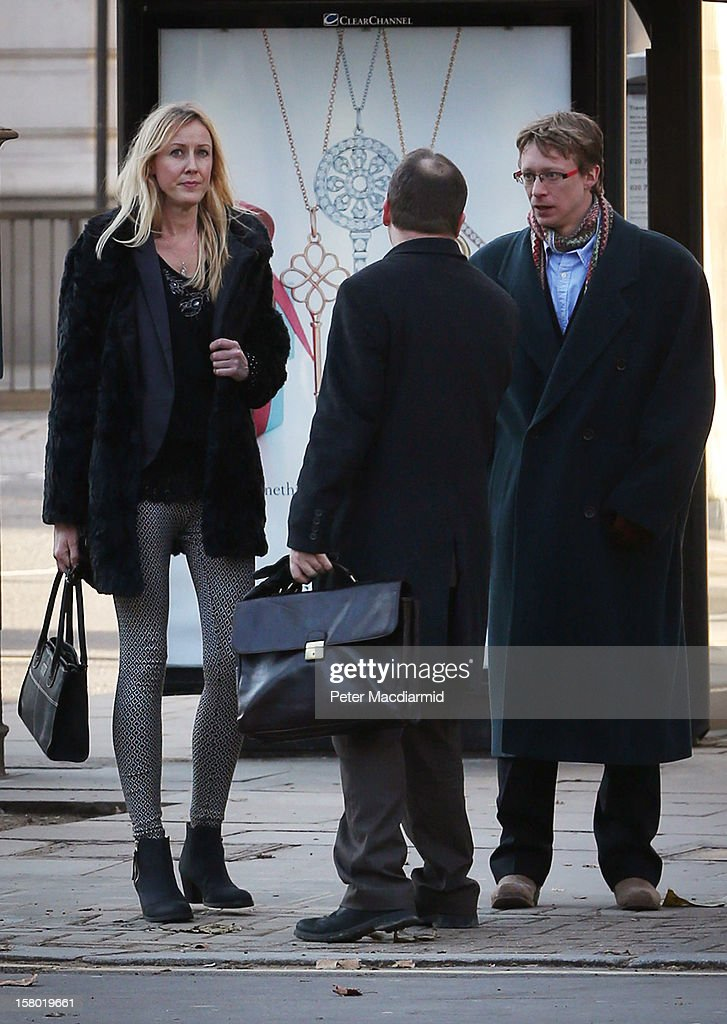 Sally Roberts (L) and Ben Roberts (R) mother and father of Neon Roberts, arrive at The High Court on December 8, 2012 in London, England. A judge has delayed a ruling on whether a local health authority should give a seven-year-old boy with a brain tumour cancer treatment against his mother's wishes.