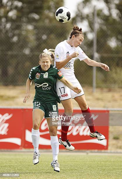 Sally Rojahn of Canberra United and Tiarn Powell of Adelaide United contest a high ball during the round nine W-League match between Canberra United...