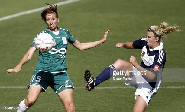 Sally Shipard of Canberra United and Amy Jackson of Melbourne Victory contest possession during the round four W-League match between Canberra United...