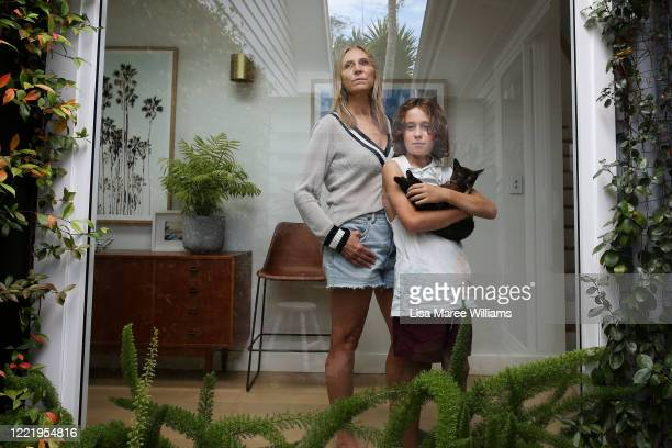 Sally Stokes owner of 'Bestoked' an event construction company isolates at home with her son Archie Stokes and their cat Poppi on April 29 2020 in...