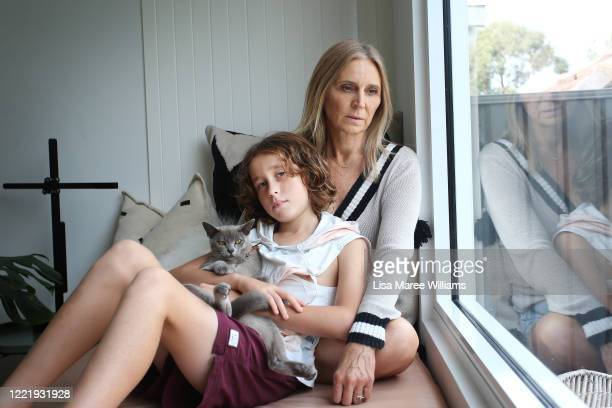 Sally Stokes owner of event construction company Bestoked isolates at home with her son Archie Stokes and their cat Larry on April 29 2020 in Sydney...