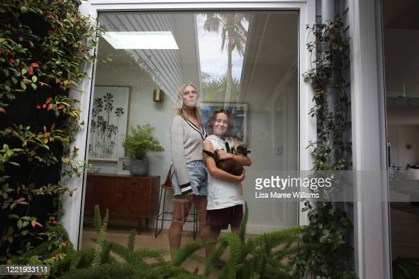 Sally Stokes owner of event construction company Bestoked isolates at home with her son Archie Stokes and their cat Poppi on April 29 2020 in Sydney...