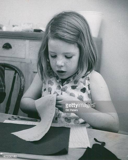 MAR 14 1968 MAY 4 1968 MAY 8 1968 Sally Sweeney of 2590 Bellaire St gives all her attention to making cutouts in her day filling creative art class