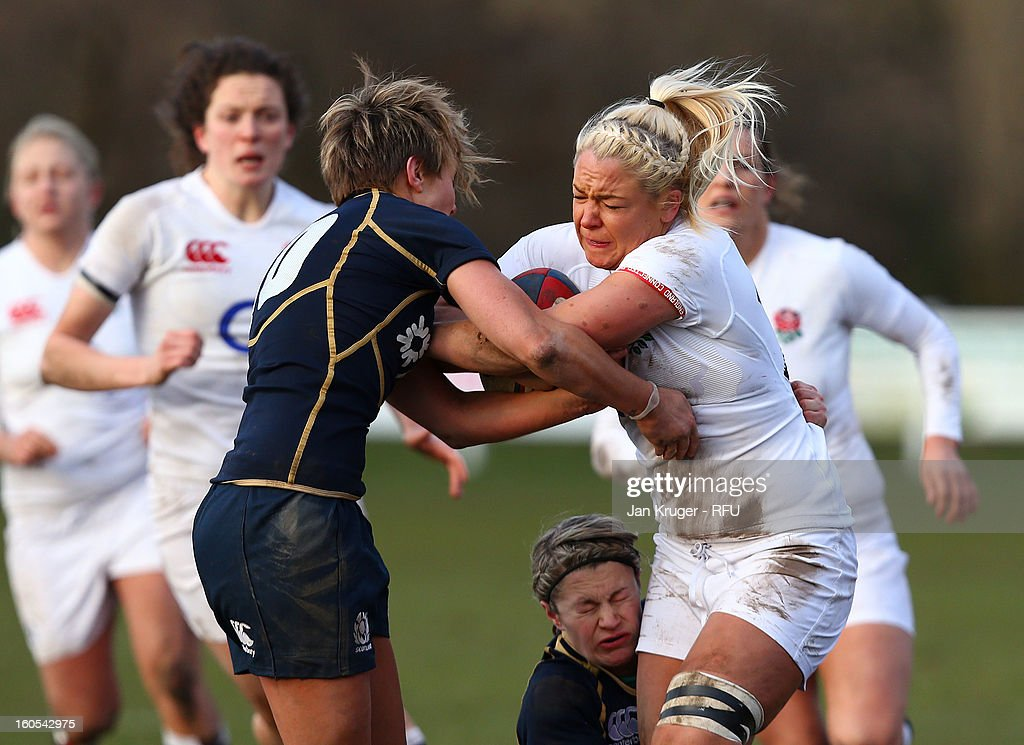 Sally Tuson of England Women crashes into Tanya Griffith of Scotland during the Womens Six Nations match between England and Scotland at Esher RFC on February 2, 2013 in Esher, England.