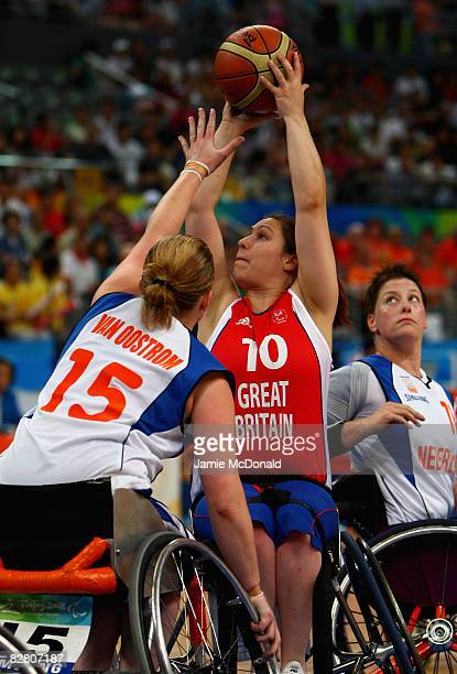 Sally Wagner of Great Britain takes a shot in the Wheelchair Basketball match between Holland and Great Britain at the National Indoor Stadium during...