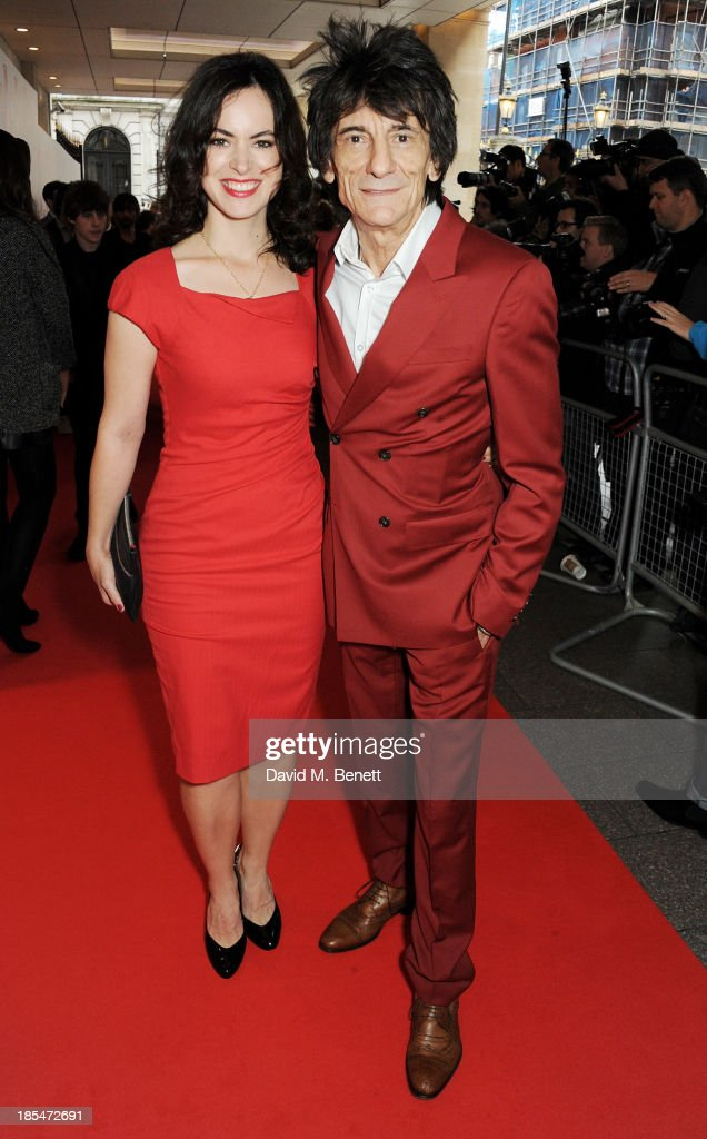Sally Wood (L) and Ronnie Wood arrive at The Q Awards at The Grosvenor House Hotel on October 21, 2013 in London, England.