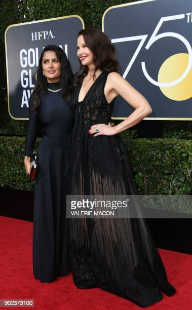 Salma Hayek and Ashley Judd arrive for the 75th Golden Globe Awards on January 7 in Beverly Hills California / AFP PHOTO / VALERIE MACON