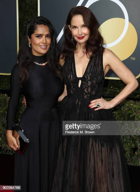 Salma Hayek and Ashley Judd attend The 75th Annual Golden Globe Awards at The Beverly Hilton Hotel on January 7 2018 in Beverly Hills California
