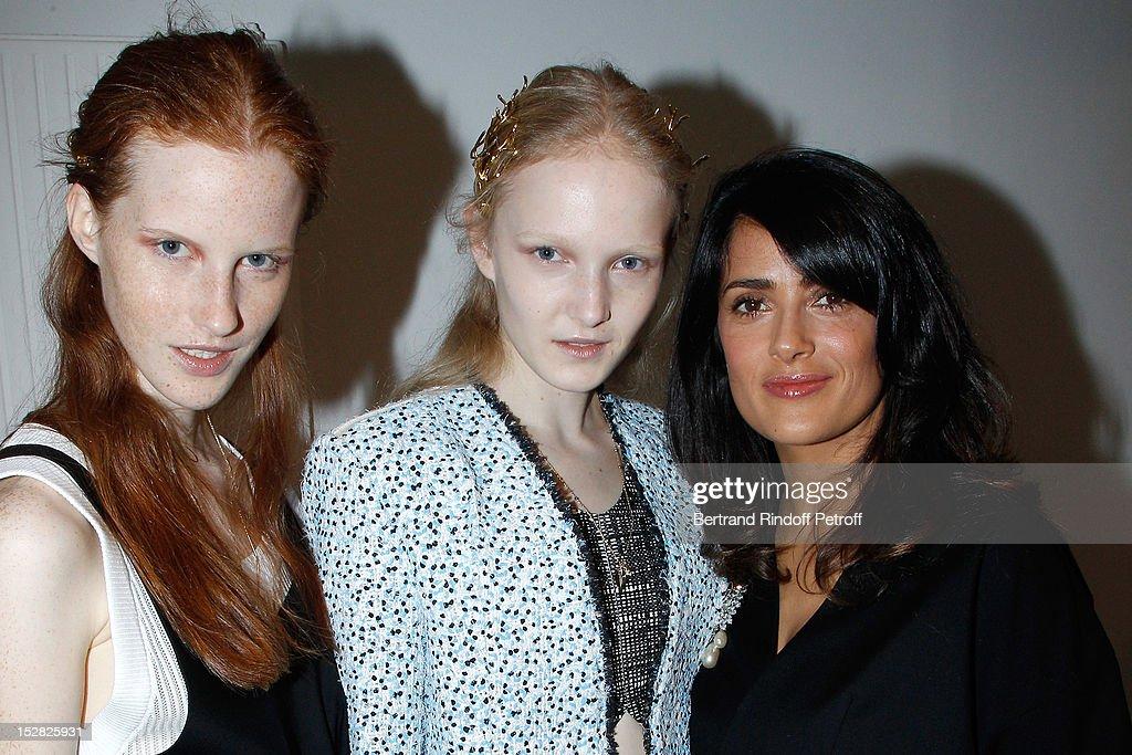 Salma Hayek (R) and Balenciaga models attend the Balenciaga Spring / Summer 2013 show as part of Paris Fashion Week on September 27, 2012 in Paris, France.
