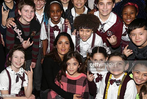 """Salma Hayek and daughter Valentina Paloma Pinault pose with the cast backstage at the matinee of Andrew Lloyd Webber hit musical """"School of Rock"""" on..."""