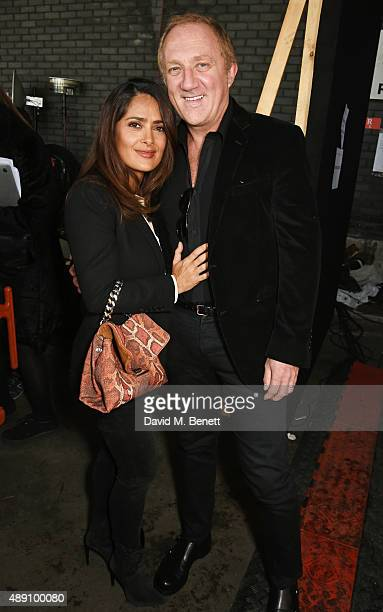 Salma Hayek and Francois Henri Pinault attend the Hunter Original Spring/Summer 2016 Collection during London Fashion Week at Euston Station Parcel...