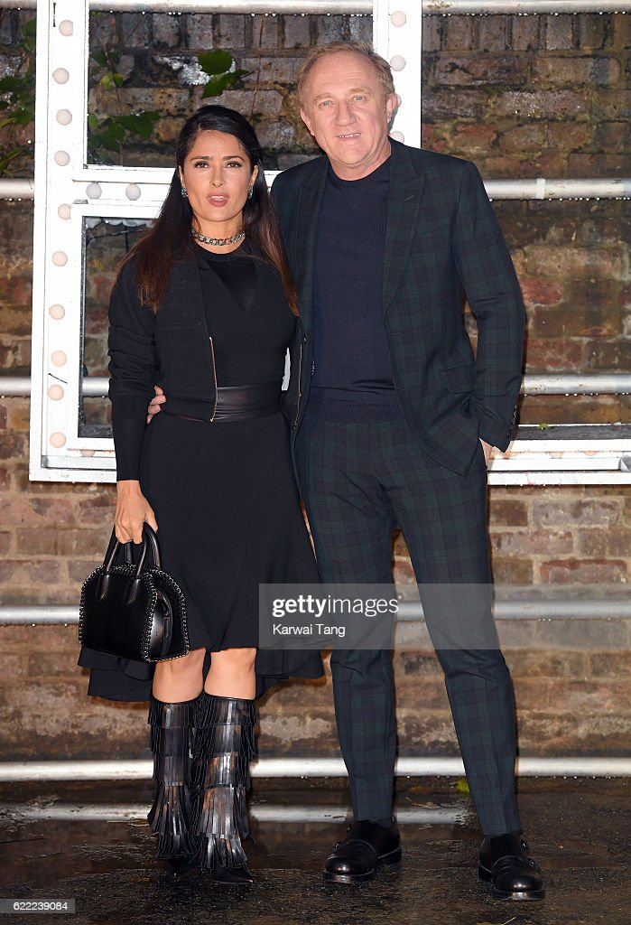 Salma Hayek and Francois-Henri Pinault arrive for the Stella McCartney Resort collection and menswear launch at Abbey Road Studios on November 10, 2016 in London, England.