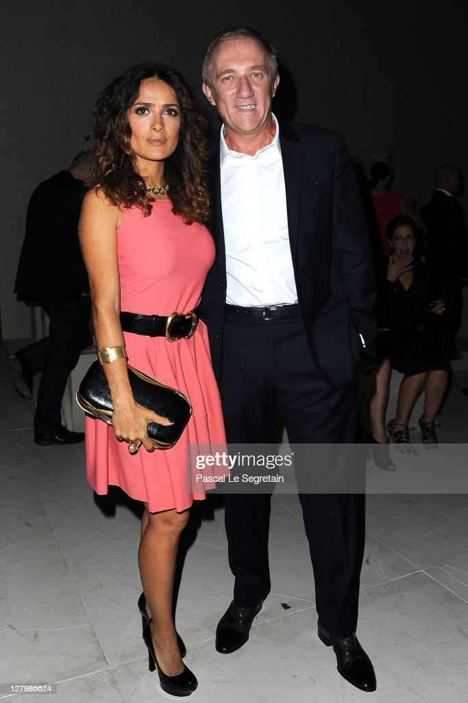 Salma Hayek and Francois-Henri Pinault attend the Alexander McQueen Ready to Wear Spring / Summer 2012 show during Paris Fashion Week on October 4, 2011 in Paris, France.
