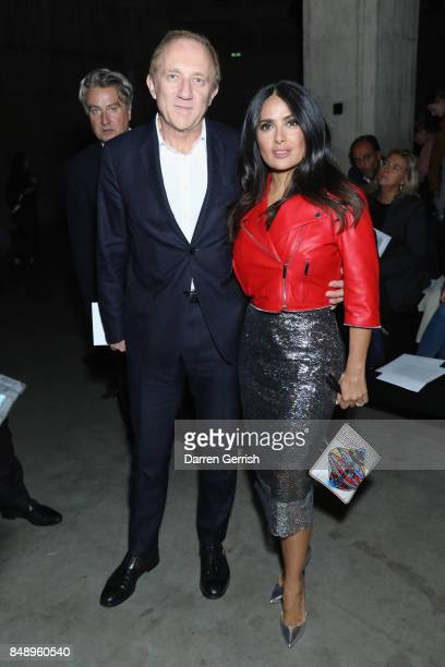 Salma Hayek and FrancoisHenri Pinault attend the Christopher Kane show during London Fashion Week September 2017 on September 18 2017 in London...