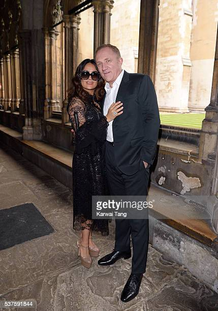 Salma Hayek and FrancoisHenri Pinault attend the Gucci Cruise 2017 fashion show at the Cloisters of Westminster Abbey on June 2 2016 in London England
