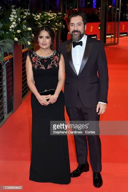 """Salma Hayek and Javier Bardem pose at the """"The Roads Not Taken"""" premiere during the 70th Berlinale International Film Festival Berlin at Berlinale..."""